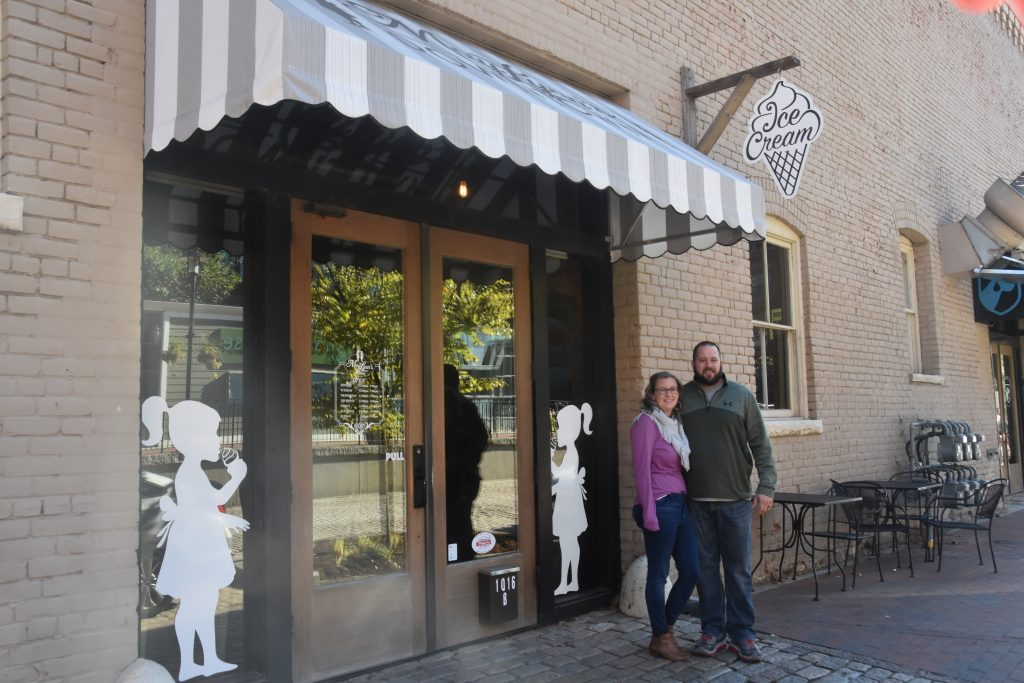 Owners standing outside Downtown Location